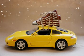 Yellow toy car and Christmas decoration - image gratuit #304095