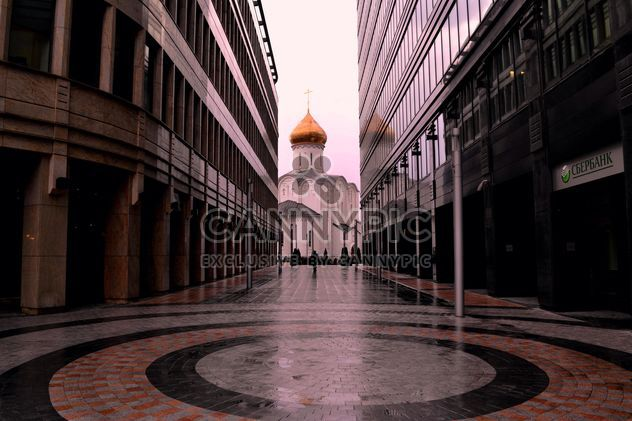 View on church between two buildings - Free image #317385