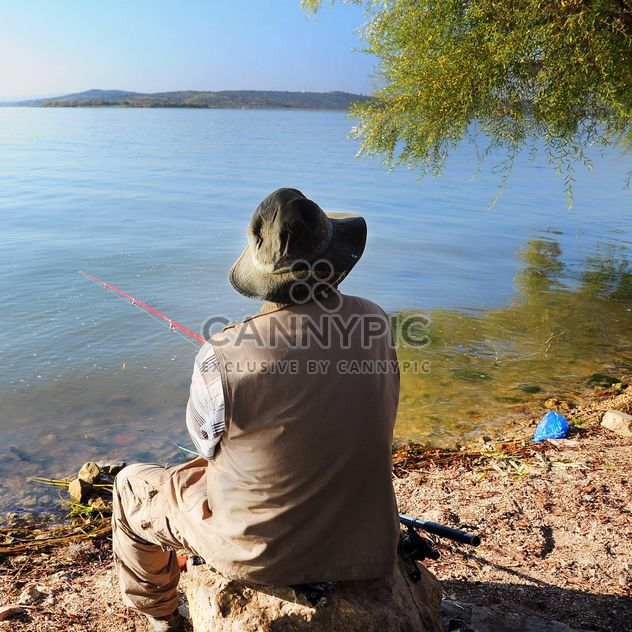 fisherman near the lake - Free image #326555