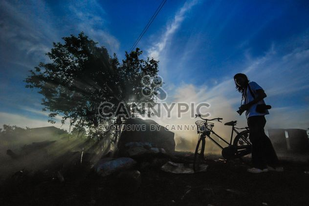 Girl with bicycle at sunset - Free image #330385