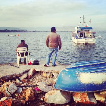 Fishermen on the rocky shore, Greece - бесплатный image #331775