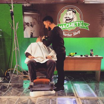 Barber shaving mustache of man - Free image #332235