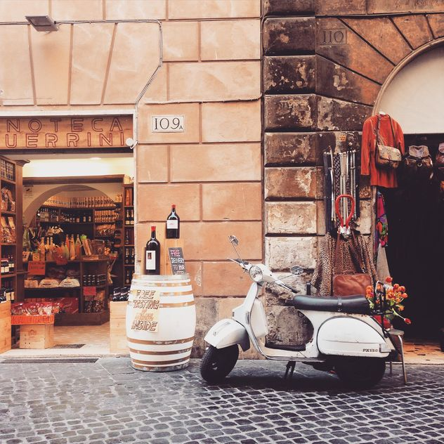 Retro Vespa scooter in street of Rome - бесплатный image #332275