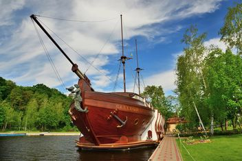 Brown vessel boat moored on river - Free image #333145