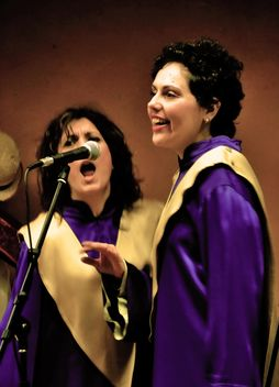 People in purple mantels singing gospel - image #333775 gratis