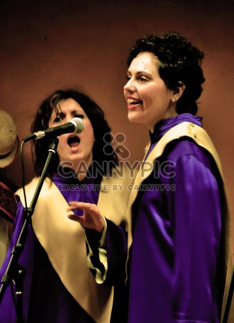 People in purple mantels singing gospel - Free image #333775