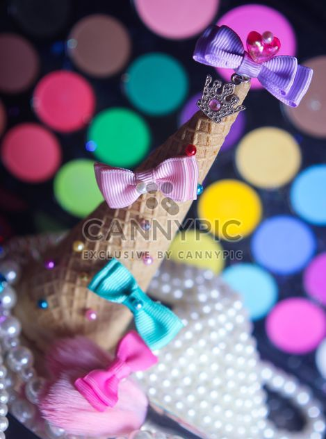 Icecream cone with ribbons and stars on a background of colorful eyeshadow palette - Free image #341505