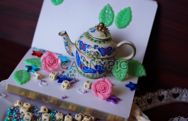 diary, watering can decorated with flowers and ribbons - Free image #342115