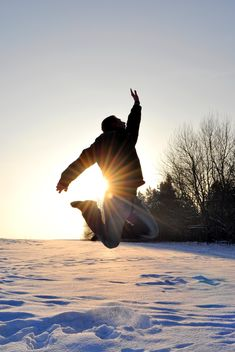 Happy man jumping on snow - Free image #346605