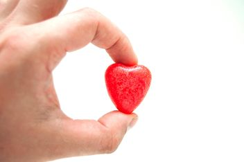 Small heart in hand on white - image gratuit #346625