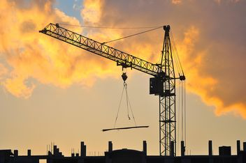 Construction crane at sunset - Free image #346895