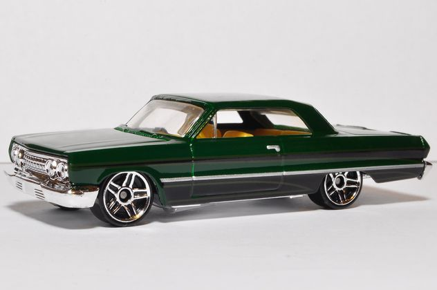 Small model of green automobile on white background - image #346935 gratis