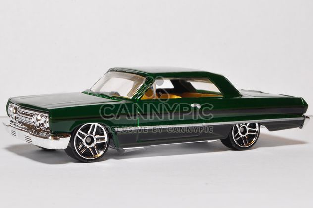 Small model of green automobile on white background - image gratuit #346935