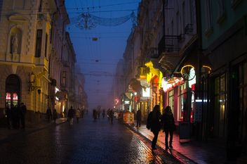 People and architecture on night street - бесплатный image #346945