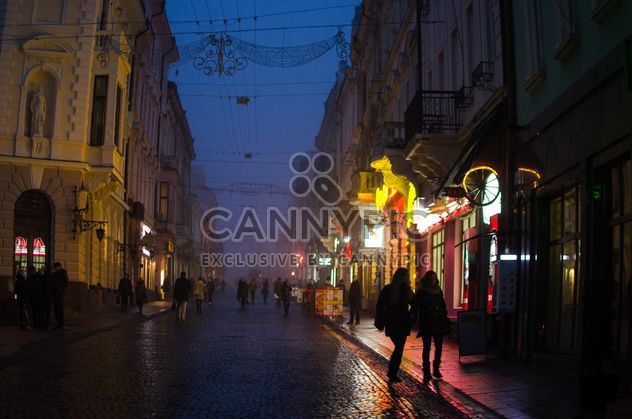 People and architecture on night street - Free image #346945