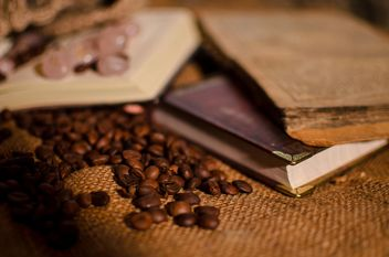 Old books, runes and coffee beans - image #346955 gratis