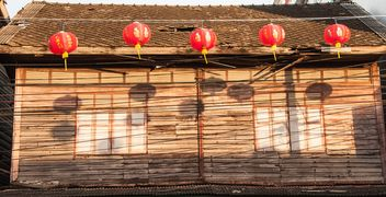 Old wooden house with red decorations - image #347205 gratis