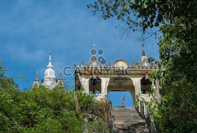 Ancient Thai temple against blue sky - image #347295 gratis