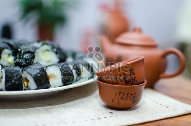 Clay cups, teapot and sushi rolls - image gratuit #347755