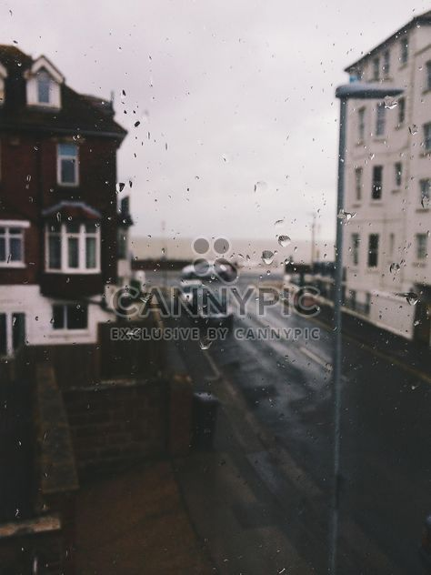 View on houses and cars on street through window - Free image #347765