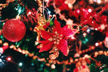 Christmas decorations on Christmas tree closeup - бесплатный image #347795