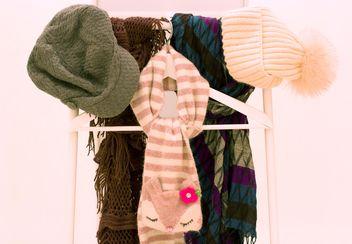Warm scarves and hats on white background - бесплатный image #347965