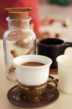 Cup of coffee and cinnamon in jar - бесплатный image #359175