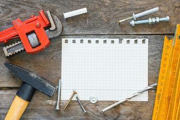 Construction tools and notebook on wood texture - image gratuit #373545