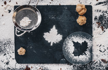 Baking backround with flour and leaf shape on black kitchen table. Top view.jpg - image #450725 gratis