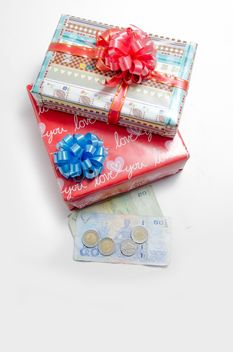 Decorated gift boxes and money on white background - бесплатный image #452545