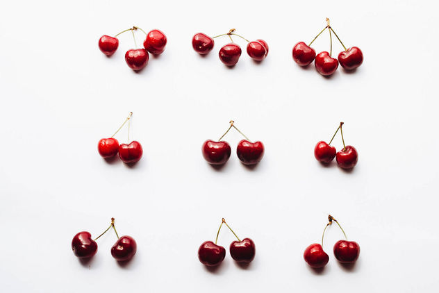 Top view of cherries on white background - бесплатный image #454355
