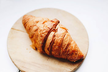 French croissant on wooden board. Close up. - image gratuit #456015