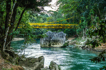 A Yellow Bridge Overpassing the Cahabon River - image #458455 gratis