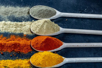 Wooden-spoons-with-spices-of-different-colors-on-a-black-background.jpg - Free image #459465
