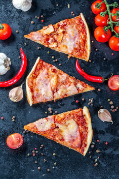Flat lay composition slices of pizza with bacon, cheese and tomato sauce - Free image #459615
