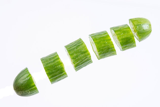 Sliced-Mini-Cucumber-in-the-air-above-white-background.jpg - image #462525 gratis